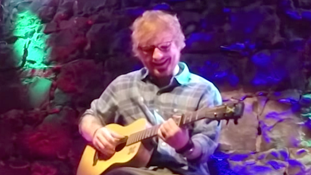 Some very surprised tourists paid $2 to see Ed Sheeran perform a 30-second 'peep show.'