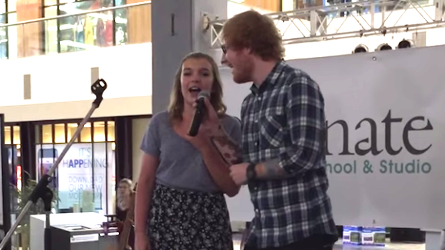 Ed Sheeran pops in for surprise duet with fan singing his song in a mall, disappears.