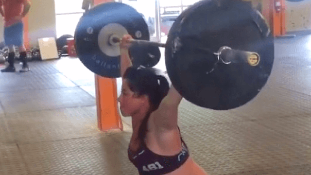 Overdue pregnant mom Emily Breeze passes the time by power-lifting the equivalent of dozens of babies.