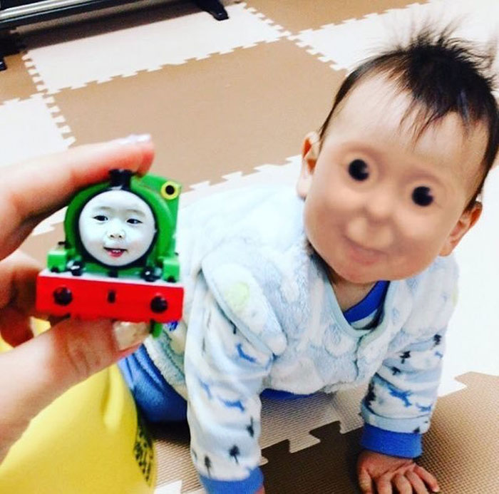 Toddler's face swap with Thomas the Tank Engine is horribly, horribly effective.