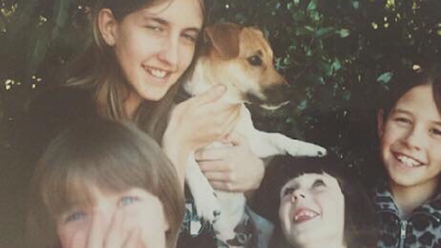 Family recreates favorite puppy photo before putting down dog of 16 years.