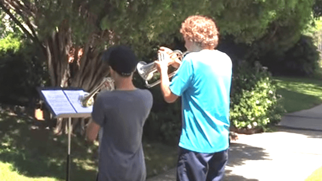 Two fans started playing 'Star Wars' on horns outside John Williams' house. He heard.