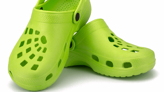 Designer introduces bejeweled Crocs at London Fashion Week, fans recoil in horror.