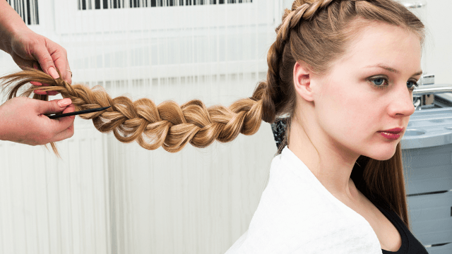 Furious father rails against daughter's 'racist' school for banning her long braids.