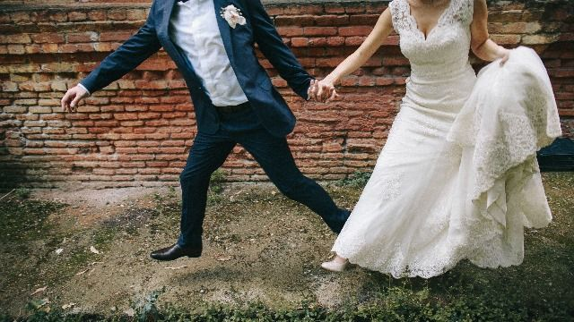 Couple busted on wedding day trying to sneak into venue they claimed was their house.