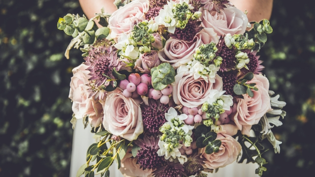 Florist shares text messages from bride who asked her to do 80 hours of free work.