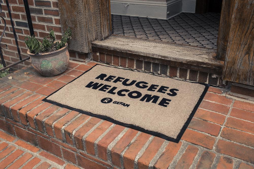 //cdn.someecards.com/posts/front---refugees-welcome-mat-2-SY1tr3.jpg