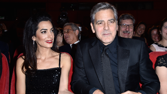 George Clooney dishes on his un-George Clooney-like reaction to finding out it was twins.