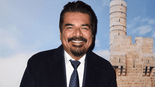 George Lopez calls woman 'b*tch' after she heckles him for racist joke.