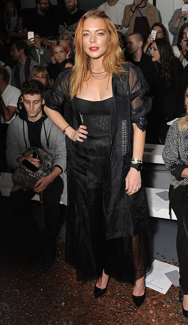 Lohan, in soberer times in the front row of London Fashion Week in September, calmly standing on a pile of pennies.