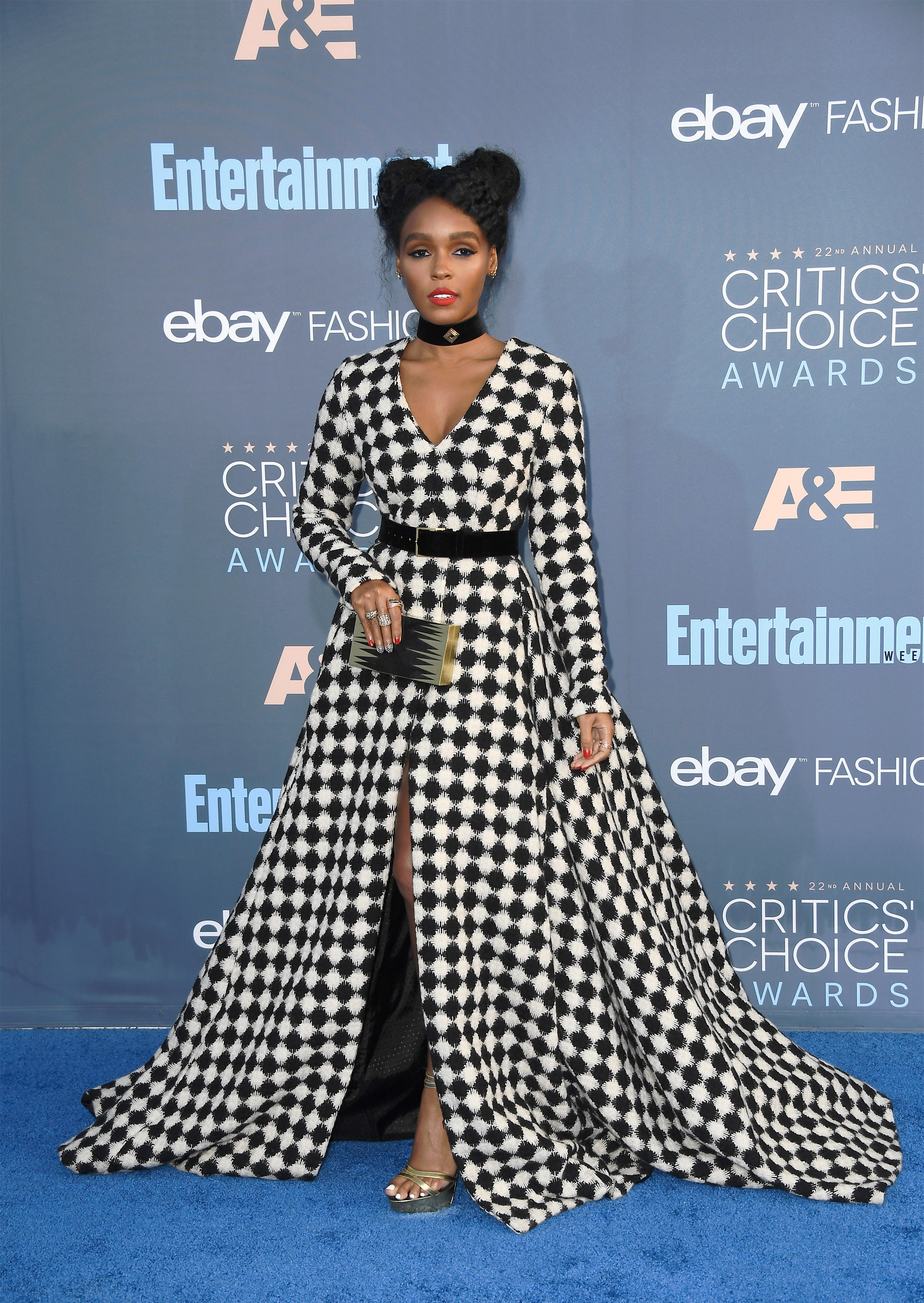 Only Janelle Monae could pull of the trinity of checkerboard, choker, and Spice Girl buns.