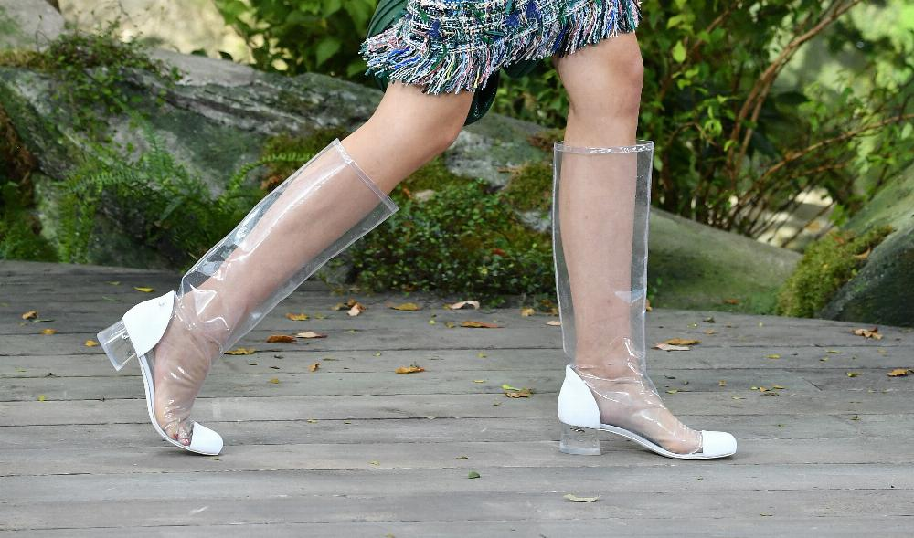 Chanel is making bizarre clear plastic boots and hats. Twitter has a lot of  feelings ac6c0aad7584
