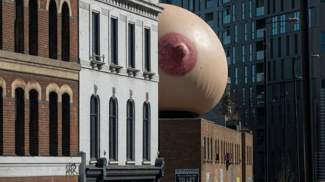 Giant boob appears atop London building to celebrate public breastfeeding on U.K. Mother's Day.