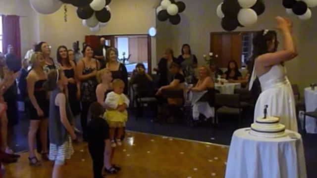 Girl forgets baby sister is subject to laws of gravity in her rush to catch a wedding bouquet.