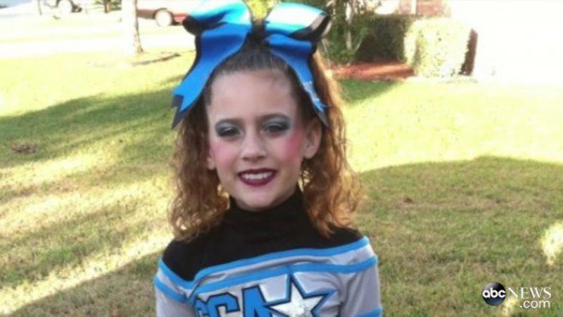 A mom is furious that her 11-year-old daughter was kicked off the cheerleading team because of hair.