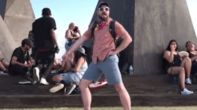 Guy trolls girlfriend trying to get the perfect photo at Coachella.