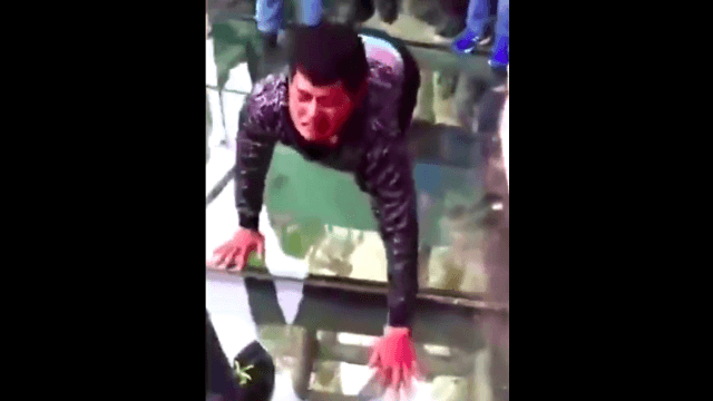 Glass walkway is supposed to be scary in a fun way. This guy didn't get the 'fun' part.