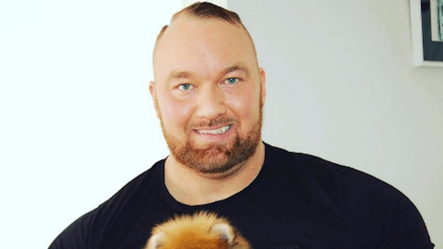 The Mountain from 'Game of Thrones' is less intimidating when he cuddles his teeny tiny fluffy Pomeranian.