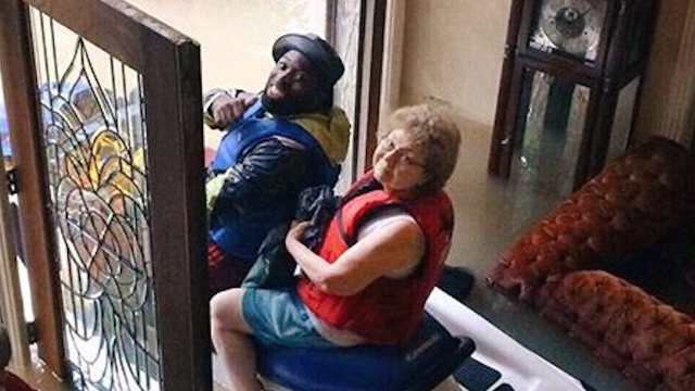 Texas grandmother saved from flooding by hero on jet ski.