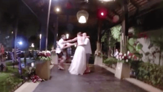 Aggressive groomsman cannot wait even one dance to throw the groom in the pool.