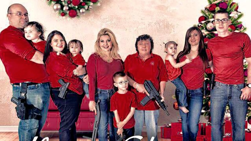 Politician raises eyebrows with holiday photo featuring heavily-armed kids.