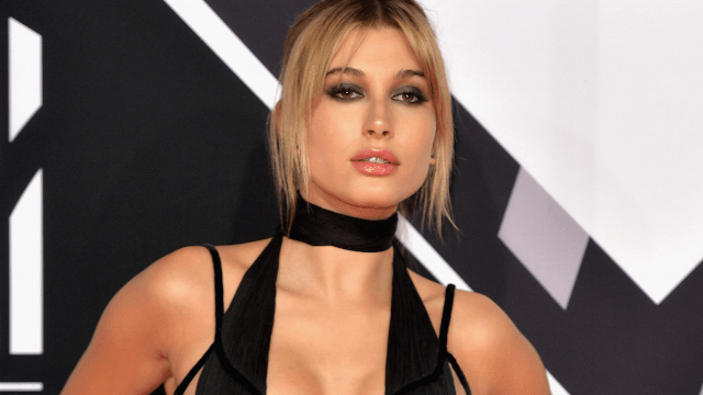 Hailey Baldwin is being sued for stealing a quote to weigh in on the Bieber/Gomez feud.