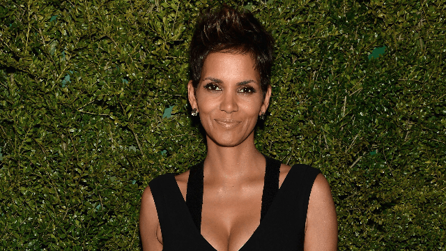 Halle Berry annoyingly proves she can pull off any hairstyle–even purple highlights.