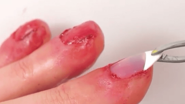 Here's a creepy AF Halloween tutorial to make it look like you don't have nails.