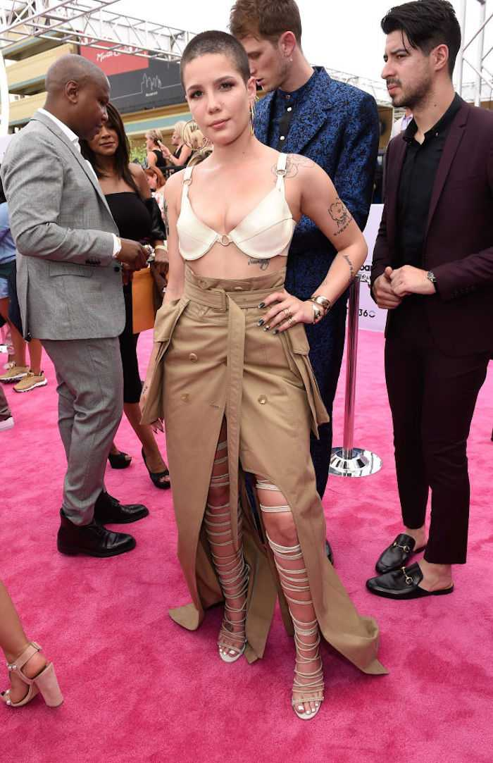 How can a bra be too tight and too saggy at the same time? Maybe Halsey should untie the trench coat from around her waist and use it to cover her outfit.