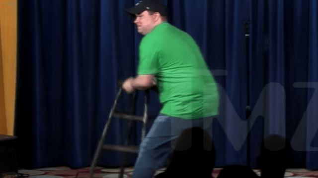 Heckler loses it, attacks comedian John Caparulo for making a joke about Donald Trump.