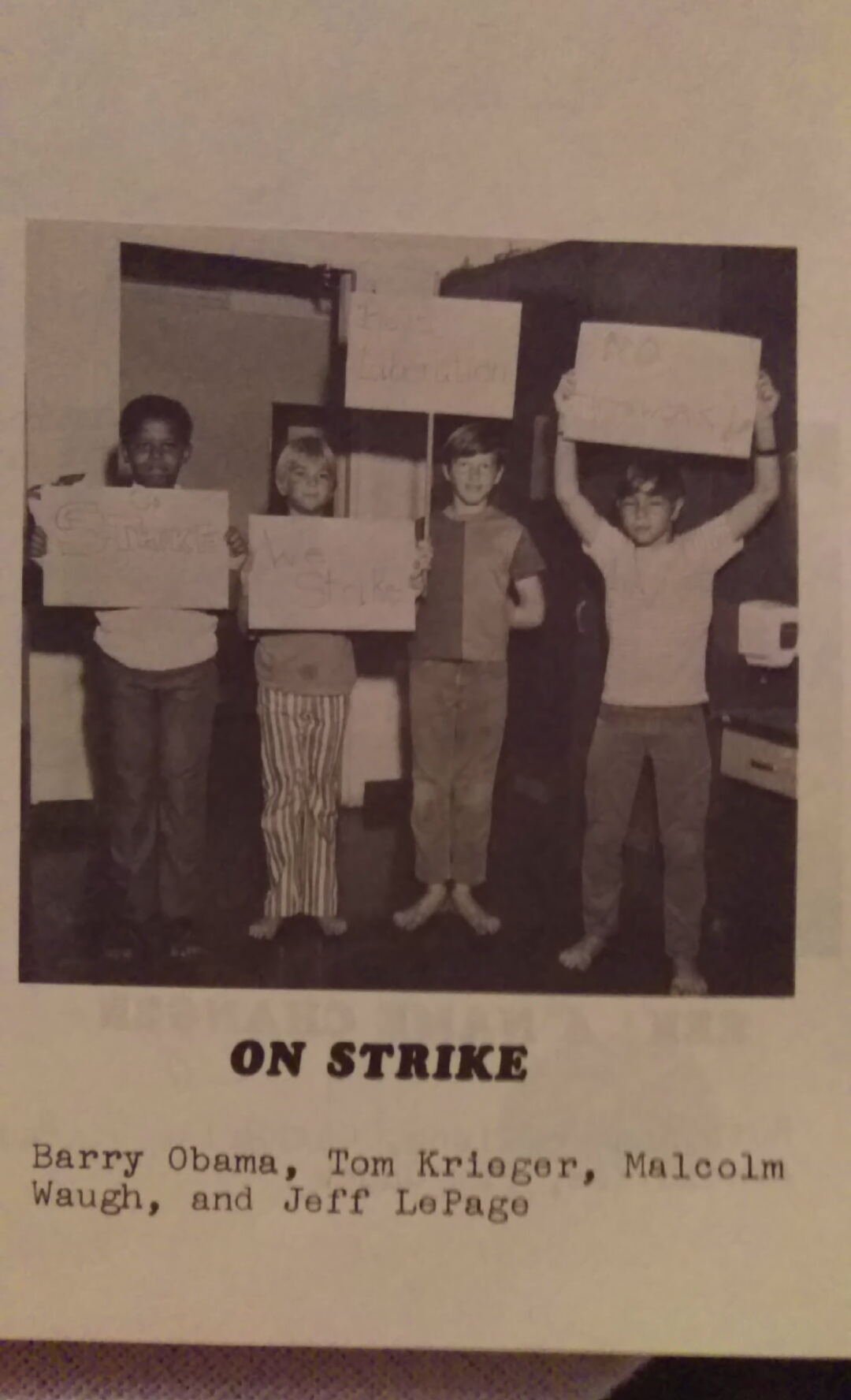 Someone found an old yearbook photo of a young Obama protesting homework.