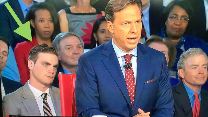 People are freaking out about the mystery hot guy sitting behind Jake Tapper at the GOP debate.