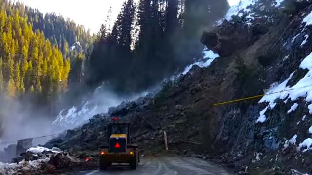 Man filming a small rockslide has to haul ass when the mountainside falls off.
