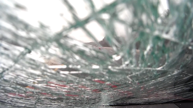 Watch a flying ice sheet destroy this car's windshield, and you'll never want to drive again.