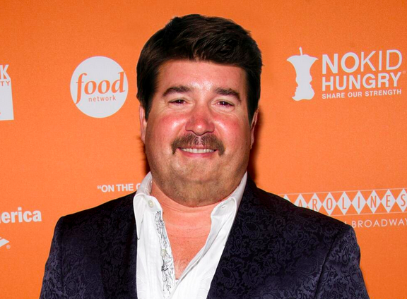 If Guy Fieri didn't have his signature hairstyle or goatee, he would look like a chubby Tom Selleck.