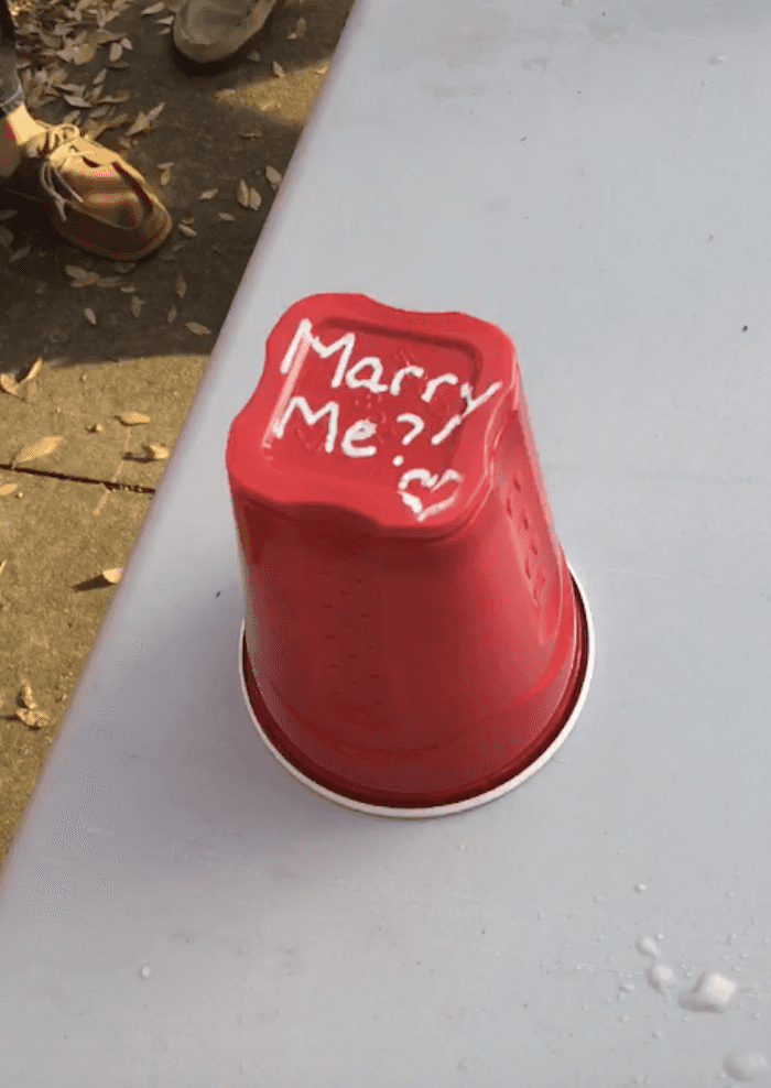 Guy's romantic proposal during game of 'flip cup' proves all you need is love and beer.