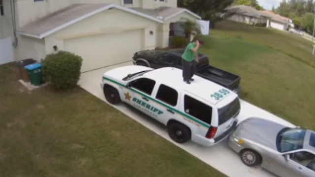 It's really fun to watch this man dance atop a cop car before getting arrested.