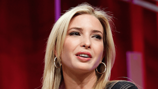Ivanka Trump's new neighbor casually sips wine while watching protesters, becomes instant icon.