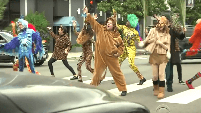Seth Rogen, Rose Byrne, and James Corden performed 'The Lion King' in a busy LA intersection.