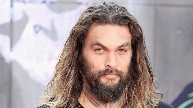People are dad-shaming Jason Momoa for letting his daughter stand next to a possibly naked rock star.