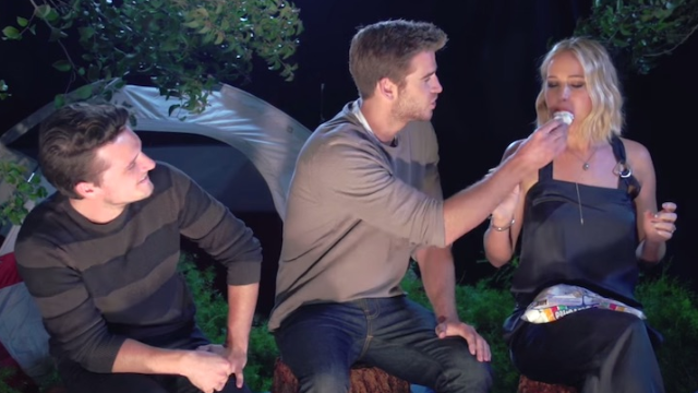 "Jennifer Lawrence, Josh Hutcherson and Liam Hemsworth play ""truth or dare"" in the woods."