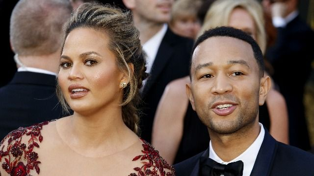 John Legend defends Chrissy Teigen, says the Michael Costello DMs are fakes.