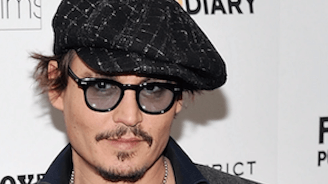 Johnny Depp interrupted a comedian's set at the Los Angeles Comedy Store.