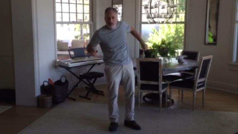 Watch Jon Stewart take the #JustKeepDancing challenge, get the crap beaten out of him.