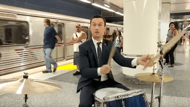 Joseph Gordon-Levitt plays drums in the subway station and impresses only himself.