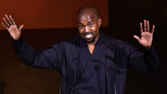 Kanye West broke up a fight between two paparazzi with a hug, much to everyone's confusion.