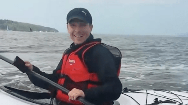 Kayakers record close encounter with a whale that was way too close.