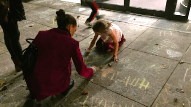 These kids writing messages for Hillary Clinton in sidewalk chalk might break your heart.