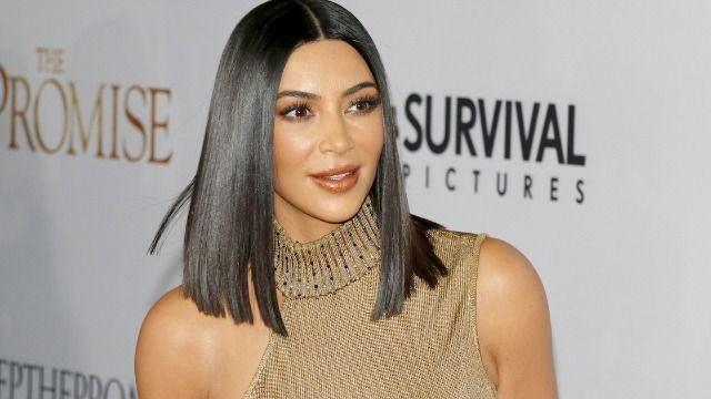 People respond to Kim Kardashian saying she doesn't promote unrealistic beauty standards.