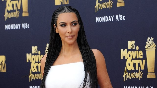 Kim Kardashian accused of cultural appropriation for braids again, and some fans are defending her.